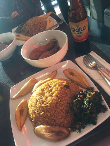 Jollof rice with chicken, plantains, and salad